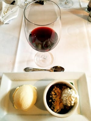 Dolphin Bar's blueberry crumble served with vanilla ice cream was paired with a BV Coastal Estates Merlot during a recent wine dinner.