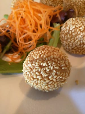 Taste of Asia's jian dui was six sesame balls.They are fried Chinese pastry made from rice flour is coated with sesame seeds on the outside and filled with sweet black bean paste.