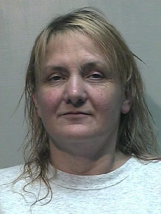 Wife of 'King of Con' gets 100 months for embezzlement
