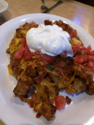 TooJay's loaded latkes were crispy potato pancake bites smothered in chopped fresh tomatoes, bacon, melted cheddar, sour cream and scallions.