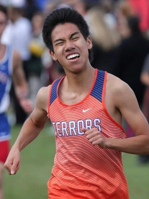 Appleton West's Kenny Mui competes in the Seymour Invitational cross country meet Thursday.