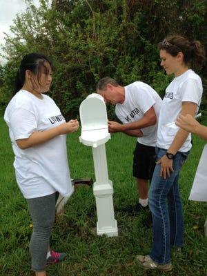 At the United Way Day of Caring volunteers spread out throughout the community, working on 60 service projects in Sebastian, Wabasso, Gifford, Fellsmere and Vero Beach. Some replaced mailboxes and house numbers that had worn down, hindering mail delivery and public services.