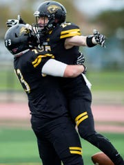 UW-Oshkosh's Austin Summers lifts Dom Todarello after Todarello scores against UW-River Falls on Oct. 27.