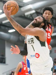James Young of the Wisconsin Herd attempts an underarm shot during a Dec. 6 game against Delaware at Menominee Nation Arena.
