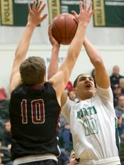 Quincy Anderson of Oshkosh North shoots over Fond du Lac's Jack Cole Friday at Oshkosh North High School December 15, 2017.