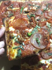 Touch of Brooklyn's 16-inch Sicilian pizza topped with