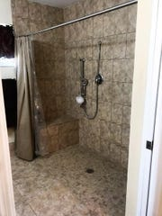 Renovations to the Poole home included a remodeled bathroom, featuring a roll-in shower.