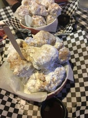 Lola's Seafood's beignets are deep-fried doughnuts