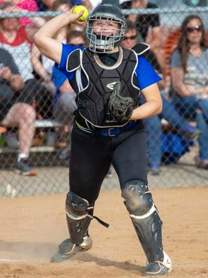 Alyssa Brewer of Oshkosh West throws the ball to first during a May 23 game.