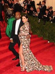 Kim Kardashian and Kanye West attend The Metropolitan