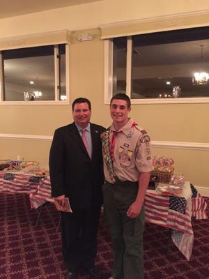 Clarkstown Supervisor Alex Gromack congratulates Frank Toto at his Eagle Scout Court of Honor.