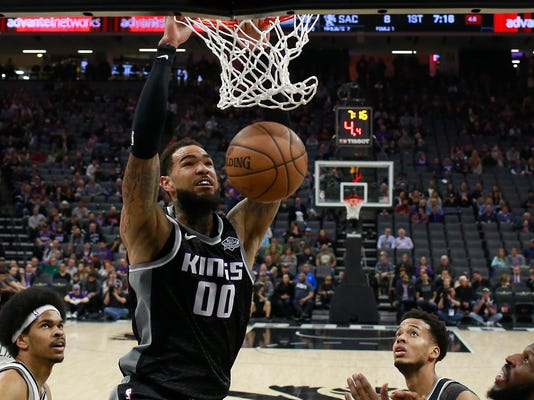 Sacramento Kings center Willie Cauley-Stein (00) stuffs as Brooklyn Nets center Jarrett Allen , left, Kings forward Skal Labissiere, second from right, and Nets forward DeMarre Carroll, right, look on during the first quarter of an NBA basketball game Thursday, March 1, 2018, in Sacramento, Calif. (AP Photo/Rich Pedroncelli)