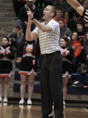 Wilmington coach Michael Noszka calls in the play.