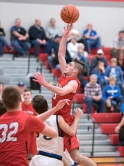 Bucyrus' Ryan Evans shoots from the lane.