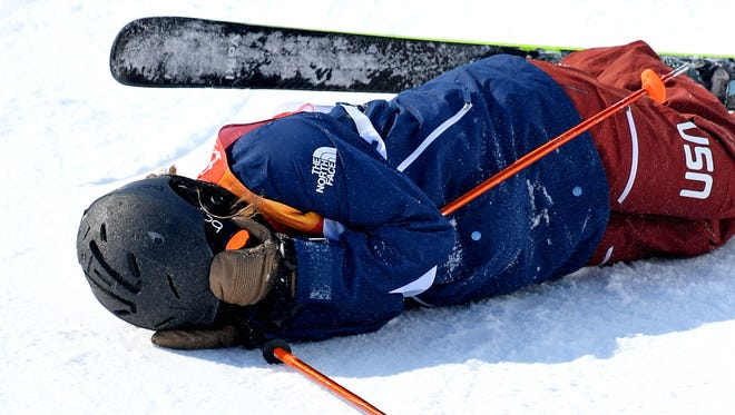 Maddie Bowman of the USA stays down after falling on her third run in the halfpipe. She did get up and ski off.