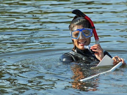 Angelica Zamora-Duran, researche. Florida Institute of Technology grad students on a pontoon boat out on the Indian River Lagoon and Turkey Creek in Palm Bay, doing research of any affects that the county dredging project is doing.