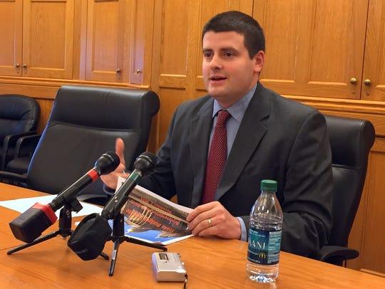 Rep. Pat Grassley, R-New Hartford, tells reporters