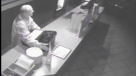 Surveillance images show a suspected burglar at a Sizzler in August