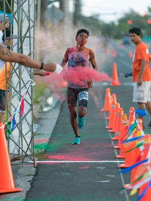 Micheal Rosario finishes first for the male category in the 9th annual Judicata 5K: Under Colors of Law in Hagåtña on April 30.