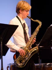 Louis Bishop class of 18 played a tenor saxophone solo during The Hun School's holiday concert.