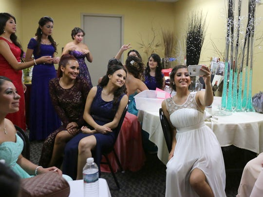 Contestants get in a photo before taking part in El Rostro Latino del Fox Valley 2015, a beauty pageant searching for the prettiest Latino face. The pageant was held Sunday at the Grand Meridian in Appleton.