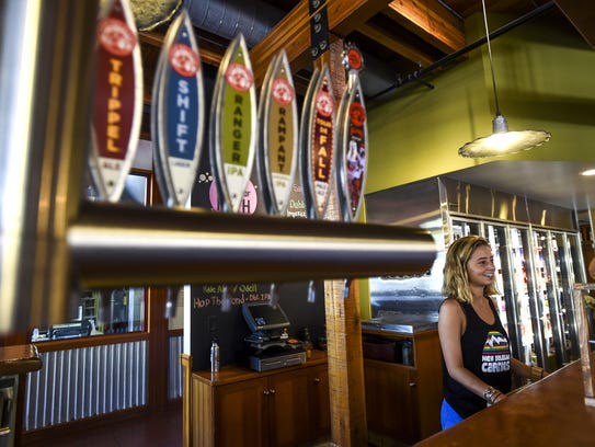 Elle Hart talks to customers at New Belgium Brewing