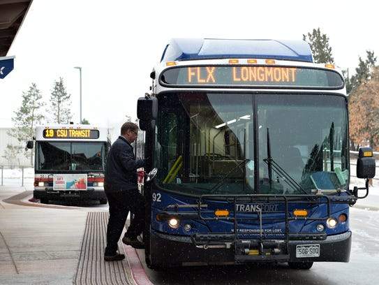 Driver Dan Kinney boards a FLEX bus at the South Transit