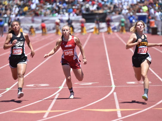 Miles' Skyler Brooks finishes the 100-meter dash May 13, 2017, during Class 2A competition at the UIL State Track and Field Championships in Austin.