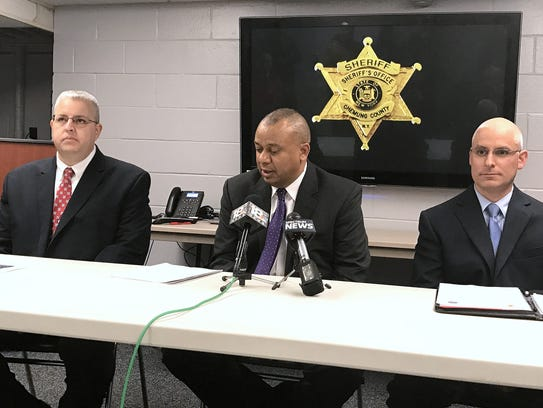 Chemung County Sheriff Christopher Moss, center, talks