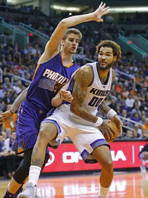 Phoenix Suns forward Dragan Bender (35) forces a turnover by Sacramento Kings center Willie Cauley-Stein (00) during the second half off their NBA game Wednesday, Oct. 26, 2016 in Phoenix, Ariz.