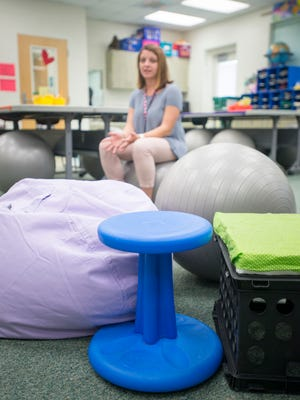 Fifth-grade teacher Rease Newton discusses the use of flexible seating, like exercise balls, bean bags and wobble chairs, in her classroom at West Pensacola Elementary on Wednesday, Aug. 23, 2017.