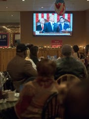 Members of the local Republican Party gather on Tuesday,