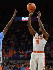 Clemson guard Gabe DeVoe (10) shoots against North