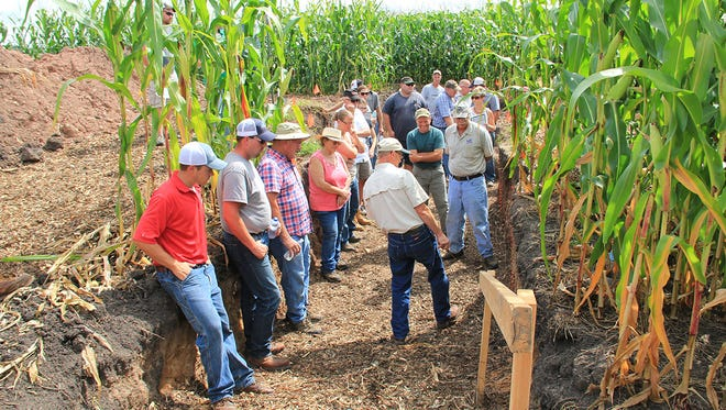 Phil Meyer, Area Resource Soil Scientist, Appleton Area Office, discusses soil health and the differences between no-till and conventional tillage in the soil pit.