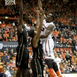 Oregon State forward Jarmal Reid (right) scores inside in last Saturday's 60-56 victory over Colorado at Gill Coliseum.