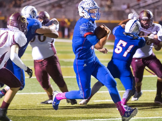 Las Cruces High quarterback Kameron Miller finds a big hole in the Gadsden defense for an easy score during the Bulldawgs 56-6 victory on Thursday night at the Field of Dreams.