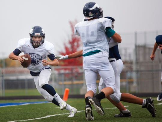 Marysville's Phill Griffor runs the ball during a drill