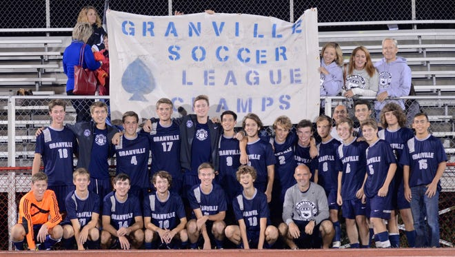 The Granville boys soccer team celebrates winning the 2014 Licking County League title