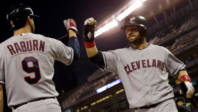 Ryan Raburn, left, Nick Swisher and the Indians have won eight in a row.