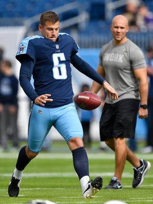 Titans punter Brett Kern (6) warms up before the start of a game against the Ravens on Nov. 5.