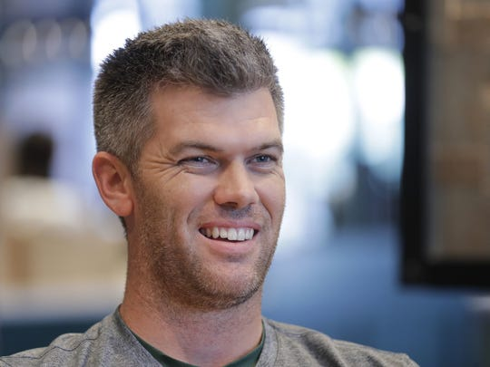 Green Bay Packers kicker Mason Crosby chats during a break while shooting a commercial for Lodge Kohler in Ashwaubenon.