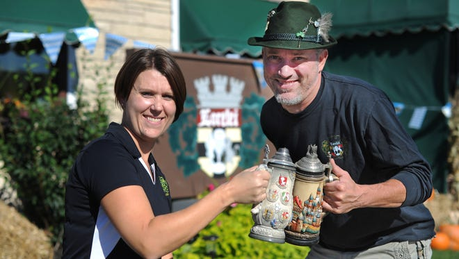 Lorelei Inn owners Meagan Colombo, left, and Dave Hack expect more than 3,000 people at their ninth annual Oktoberfest this weekend in Allouez.