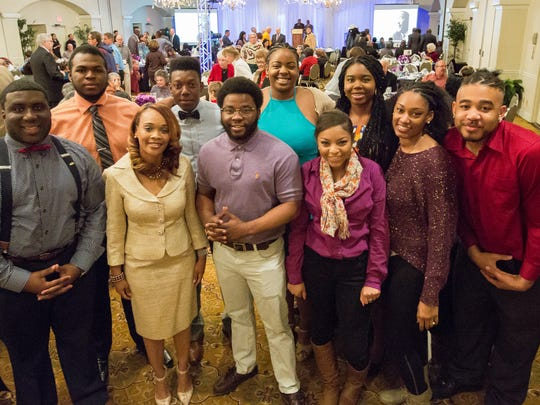 Members of the New Mexico State University's Youth & College Division of NAACP pose for a photograph on Monday, January 16, 2017 during the annual Doña Ana County NAACP Martin Luther King Breakfast at Hotel Encanto de Las Cruces. Pictured in the background, from left, Kevan Henry, Gasper Martinez, Eryca Wafer, Mariah Walker. Foreground, from left, Meligha Garfield, president Kimberly York, Raymond Berry, Allyssa Cox, Jade Davis and Mar'kel Jefferson.