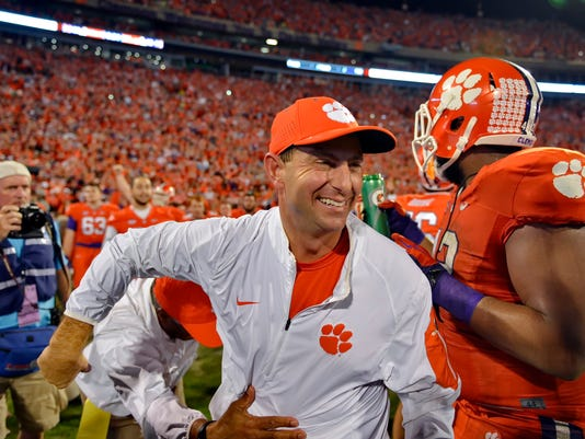 FILE - In this Nov. 7, 2015, file photo, Clemson head coach Dabo Swinney celebrates after their 23-17 win over Florida State in an NCAA college football game in Clemson, S.C. Alabama is No. 1 in The Associated Press preseason Top 25. Clemson is No. 2. (AP Photo/Richard Shiro, File)
