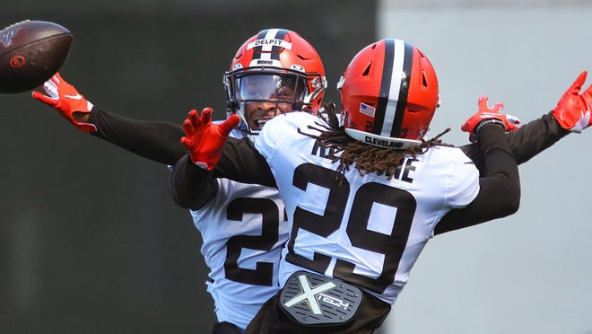 Cleveland Browns safety Sheldrick Redwine (29) breaks up a pass intended for Cleveland Browns safety Grant Delpit (22) during safety drills during practice at the NFL team's training facility, Wednesday, Aug. 19, 2020, in Berea, Ohio.