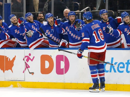 New York Rangers defenseman Marc Staal (18) celebrates after scoring a goal against the Winnipeg Jets during the second period of an NHL hockey game, Sunday, Dec. 2, 2018, in New York. (AP Photo/Noah K. Murray)