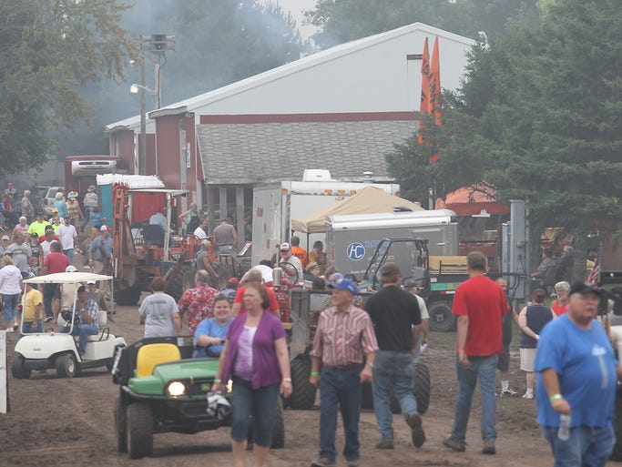 The North Central WI Antique Steam & Gas Engine Club's annual Antique Show and Flea Market near Edgar was busy despite some less than ideal weather conditions , Saturday, August 23, 2014.