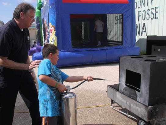 Eddy County Fire Marshal Robert Brader showed kid's