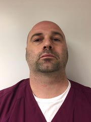 This undated photo provided by the Pennsylvania Attorney General's Office shows Michael David Bragg. Bragg, a former nurse faces hundreds of charges because investigators say he secretly recorded people, including patients at the Pennsylvania hospital where he worked, and sexually assaulted an unconscious woman in the emergency room. State prosecutors on Wednesday, Dec. 18, 2019 filed charges against 39-year-old Chambersburg resident Michael David Bragg. (Pennsylvania Attorney General's Office via AP)