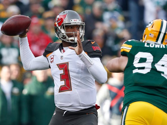 Tampa Bay Buccaneers' Jameis Winston throws during the first half of an NFL football game against the Green Bay Packers Sunday, Dec. 3, 2017, in Green Bay, Wis. (AP Photo/Matt Ludtke)